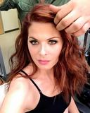 Debra Messing - Black Sports Bra photo (x1)