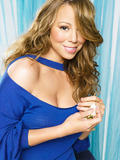 Mariah Carey shows her body (very leggy and cleavagy) in photoshoot for Parade magazine